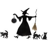 A witch with her catty companions, metal silhouettes for the front yard, is $149.99 from Dallas-based Wisteria or at wisteria.com