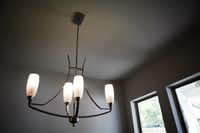 Compact fluorescent light bulbs are an eco-friendly feature at a Greenbrook Homes house on Lakeshore Drive in Dallas.
