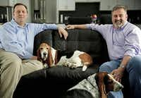 Paschall (right) and Weinstock realized the solution to their needs was to repurpose space within their home. They're shown with their bassett hounds, Luna and Boo.G.J. McCarthy - The Dallas Morning News