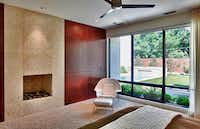 Cut shell stone surrounds a fireplace in the master bedroom.( Craig Kuhner )