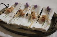 Folded napkins for a dinner party, tied with raffia, a champagne cork and lavender(Courtesy Audrey Friedman -  Audrey Friedman )