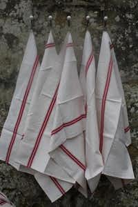Traditional kitchen towels called torchons are known for their red stripe.(Courtesy Audrey Friedman -  Audrey Friedman )