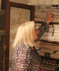 Friedman shops for finds in a cupboard of antique linens at a dealer's studio.(Courtesy Audrey Friedman -  Audrey Friedman )