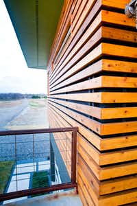 Tauri and Jonathan liked this wood-slat rain screen pictured on Houzz.com and had a similar one installed at their house.