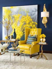 The designers pick every detail, from fabric to nailheads, as with a vivid yellow leather wingback chair.( Dan Piassick  -  Piassick Photography )