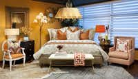Shades of amber, copper, tangerine and apricot brighten a bedroom vignette.Dan Piassick  -  Piassick Photography