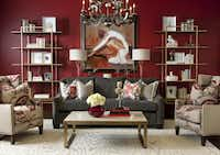 A red wall forms the backdrop for a living room vignette that mixes traditional and contemporary design elements.Dan Piassick  -  Piassick Photography