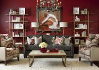 A red wall forms the backdrop for a living room vignette that mixes traditional and contemporary design elements.( Dan Piassick  -  Piassick Photography )