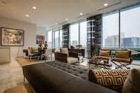 The living and dining areas of the penthouse are flanked by 42 feet of continuous glass facing downtown Dallas.( Milton Johnson  -  Shoot2Sell Photography )