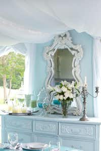 An inexpensive vintage dresser was painted pale aqua for the outdoor wedding reception at the author's plantation.Keith Scott Morton and Eric Richards  -  CICO Books