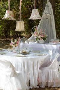 "Carolyn Westbrook lives to decorate. Her daughter's bridal shower, held at the plantation, was set in layers of white voile and linen. ""Over the top"" was the author's goal.( Keith Scott Morton and Eric Richards  -  CICO Books )"