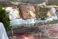 Pillows sewn in feminine florals cushion iron seating for an outdoor party held under the shade of live oaks.Keith Scott Morton and Eric Richards  -  CICO Books