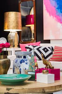 Lacquer pink packs a punch in Leslie Pritchard's space. The Again & Again shop owner paired the trendy, bold color with graphic black and white elements to add visual interest and liveliness to the room.