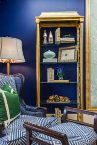 IBB Design Fine Furnishings of Frisco created drama with deep-blue walls complemented by emerald pillows and blue textiles.