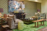 Stencilled walls in lively green add to the funky character of Dallas studio William-Christopher Design's setting. A variety of finishes, wood tones, mirrored pieces and lacquer add richness.