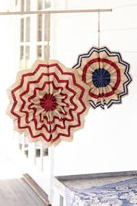 Stars and stripes: Display burlap pinwheels on a deck, gazebo or front door for a flag-loving statement. $18.50 to $22.50 on sale, at Pottery Barn, Dallas, Southlake and Frisco.(Laura Resen Michael Bennett -  Pottery Barn )