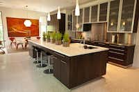 The spacious open kitchen in one of the tour houses features terrazzo floors.(unknown)