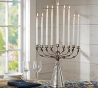 A menorah with an etched, mercury-glass base is $118.99 at potterybarn.com.