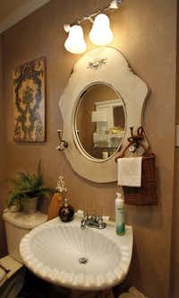 The latest re-do of Fran Holley's house is based on neutrals and earthy colors. Here, a clamshell sink.