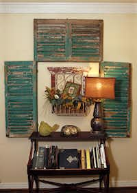An arrangement of old shutters creates a nook in the living room.