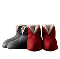 Down-lined foot duvets will keep her feet comfy and cozy on cold winter nights. Non-skid soles keep footing secure. Machine washable. Available in seven colors and two sizes: small/medium and large/extra large. $19 at Restoration Hardware, Dallas and Plano, and restorationhardware.com