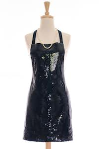 Classic black is just right for holiday entertaining, even in the kitchen. She'll greet party guests while wearing this festive sequined apron. One size fits most. Adjustable button neck strap. $50 at BarbaraAnneCo.com