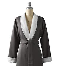 She'll believe she's at the spa when wrapped in this plush robe lined in cotton terry. Styled with a wide, rolled collar and self-tie belt, the robe may be monogrammed to make it distinctively her own. Offered in five colors and three sizes: small, medium and large. $99 at Restoration Hardware, Dallas and Plano, and restorationhardware.com