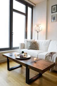 The main room of the Morrises' studio apartment in the Chelsea meighborhood in Manhattan.HomePolish
