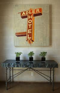The entryway to Ken Maxwell's home features a painting of the Adler Hotel sign in East Dallas.
