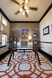 Farhan Mohammad's home office maintains the feel of the house while announcing his passion for the University of Texas.