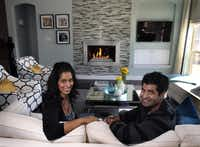 Farah (left) and and Farhan Mohammad in the living room of their Lewisville home.