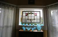 A stained glass window in the dining room at Jackie and Doug Sweat's home on Junius Street in Munger Place  on Tuesday, August 27, 2013.