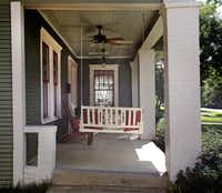 The front porch of Jackie and Doug Sweat's home on Junius Street in Munger Place  on Tuesday, August 27, 2013.