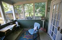 "The upstairs ""sleeping porch"" of Jackie and Doug Sweat's home on Junius Street in Munger Place  on Tuesday, August 27, 2013."