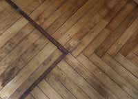 A look at the wood pattern on the floor in the dining room at Doug and Jackie Sweat's home on Junius Street in Munger Place  on Tuesday, August 27, 2013.