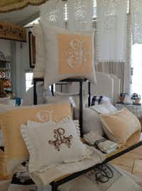 Pandora de Balthazar sets up shop in spring and fall at Round Top for the weeks-long antiques fair. Female shoppers hang out in the air-conditioned tent and try out Pandora's sleep system of pillows, duvets and more. Her staff envelops shoeless shoppers in beds and encourages them to take a nap.
