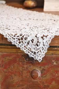 Antique linens by de Balthazar are showcased at the Mews in the Dallas Design District. She often schedules trunk shows there.