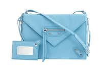 Put Mom in the skilled hands of a Neiman Marcus personal stylist. Balenciaga's Paper Zip-Around Triple Bag brings on the blue.(Neiman Marcus)