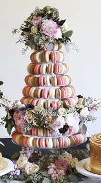 Bisous Bisous Pâtisserie's  macaron tower for May has rose and cherry blossom flavors that can be paired with blue-hued macarons like honey lavender and Earl Grey.(Bisous Bisous Pâtisserie)