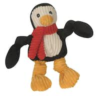 The Penguin toy for dogs, from the Huggle Hounds' Holiday Knottie collection, is made of soft, durable corduroy, with squeakers sewn inside. $19.95 small, $29.95 large at Lucky Dog Barkery, Dallas.