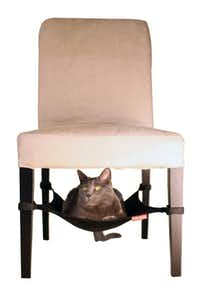 Felines can hang out under a table or chair in the space-efficient Cat Crib that attaches to furniture legs. The hammock is lined with fleece and comes in black, neutral or purple for $29.99 at Cat Connection, Dallas.