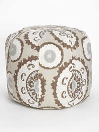 SUZANI STITCHE: Dallas interior designer and showroom owner Michelle Nussbaumer has a trio of suzani-upholstered poufs on her shop floor. We favored this circular number (left); $425 at Ceylon et Cie, Dallas. A lighter-hued take on the print, the Suzani Kantha pouf is hand-quilted in cotton voile. Also available in coral, the pouf is $128 at Nordstrom (multiple locations) and nordstrom.com.