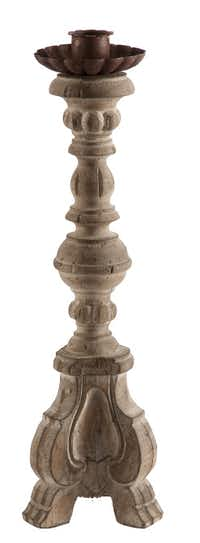 For the traditionalist, the Turin pillar candlestick rises 14 inches and includes a drip plate with a rusted effect. $181.50 each; by Aidan Gray Home at Gray Living, McKinney.