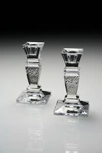 Petite Catherine hand-cut crystal by William Yeoward packs a pretty punch at only 5 inches tall. Gift-boxed pair $165 at Madison, Highland Park.