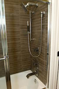 Daltile's Veranda Tones porcelain tiles were used to line a shower stall in on ABC's ninth season of Extreme Home Makeover: Home Edition.