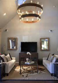Emily Sheehan Hewett paid special attention to the lighting fixtures when renovating her husband's bachelor pad. The chandelier in the living room was custom made.
