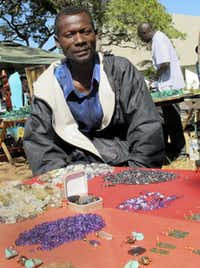 "Teddy Njapau, a peddler in Lusaka, Zambia, credits U.S.-supplied anti-retroviral drugs for his survival. ""Without them, I don't know where I'd be now,"" he said."