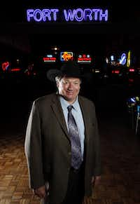 Billy Bob Barnett strikes a pose inside  Billy Bob's Texas, the cavernous Fort Worth honky-tonk that he made famous -- and lost during the real estate bust of the late 1980s.