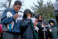 Sumeet and Pallavi Dhawan mourned the death of their 10-year-old son, Arnav, at a candlelight vigil outside their home in February. Pallavi was accused of killing the boy.( Brad Loper  -  Staff Photographer )