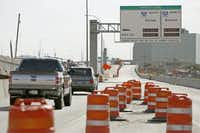 New signs on LBJ Freeway alert motorists to the soon-to-open toll connection with Interstate 35E. The connectors are the third installment in North Texas' emerging system of managed toll lanes, which is believed to be the largest planned network of its kind in the U.S.Brad Loper  -  Staff Photographer